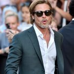 Brad Pitt wearing sun glasses